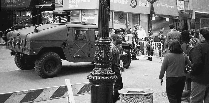 Photo: Humvee, National Guard, pedestrians